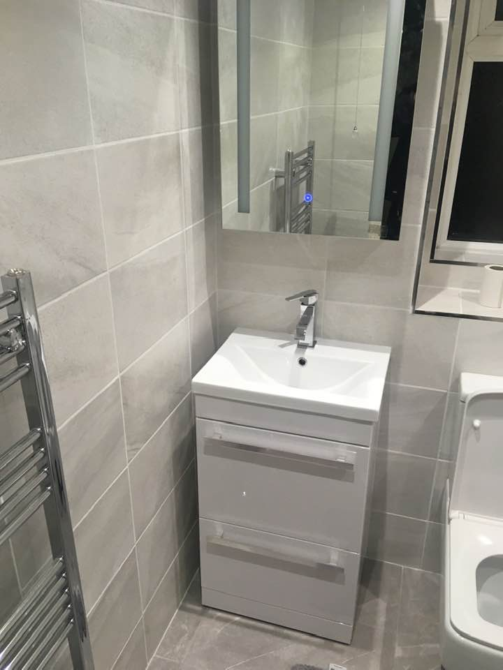 Wash basin and cabinet of completed bathroom refit by plumbers Swanse Treforys Gas Solutions